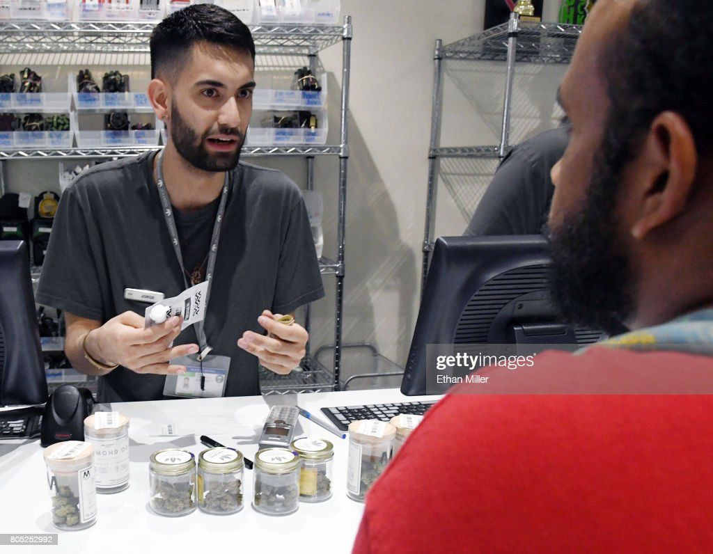 Employee Jorge Aguilera talks to a customer at Essence Vegas Cannabis Dispensary after the start of recreational marijuana sales began on July 1, 2017 in Las Vegas, Nevada. Nevada joins seven other states allowing recreational marijuana use and becomes the first of four states that voted to legalize recreational sales in November's election to allow dispensaries to sell cannabis for recreational use to anyone over 21.