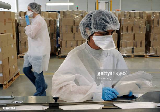 Employee Katia Fernandez performs a quality control check on masks at the end of the production line in the Sperian face protection mask factory in...