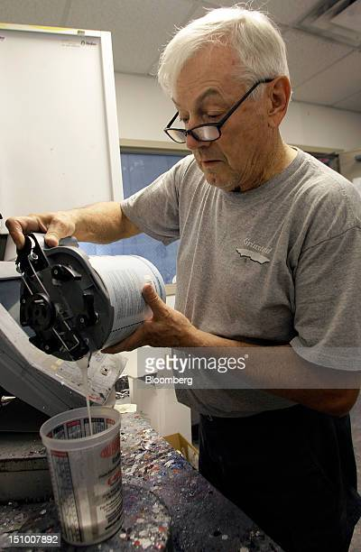 Employee Kenneth Horsley mixes DuPont Co. Auto-paint at Haydocy Automotive in Columbus, Ohio, U.S., on Thursday, Aug. 30, 2012. Carlyle Group LP, the...