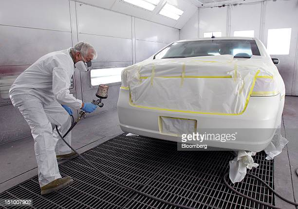 Employee Kenneth Horsley paints a car with DuPont Co. Auto-paint at Haydocy Automotive in Columbus, Ohio, U.S., on Thursday, Aug. 30, 2012. Carlyle...