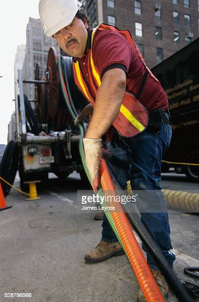 RCN Employee Laying Fiber Optic Cable
