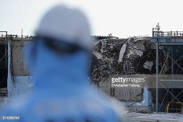 TEPCO employee looks at the a destroyed reactor at Fukushima Daiichi nuclear power plant Five years on the decontamination and decommissioning...