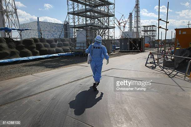 TEPCO employee makes their way through the Fukushima Daiichi nuclear power plant on February 24 2016 in Okuma Japan Five years on the decontamination...