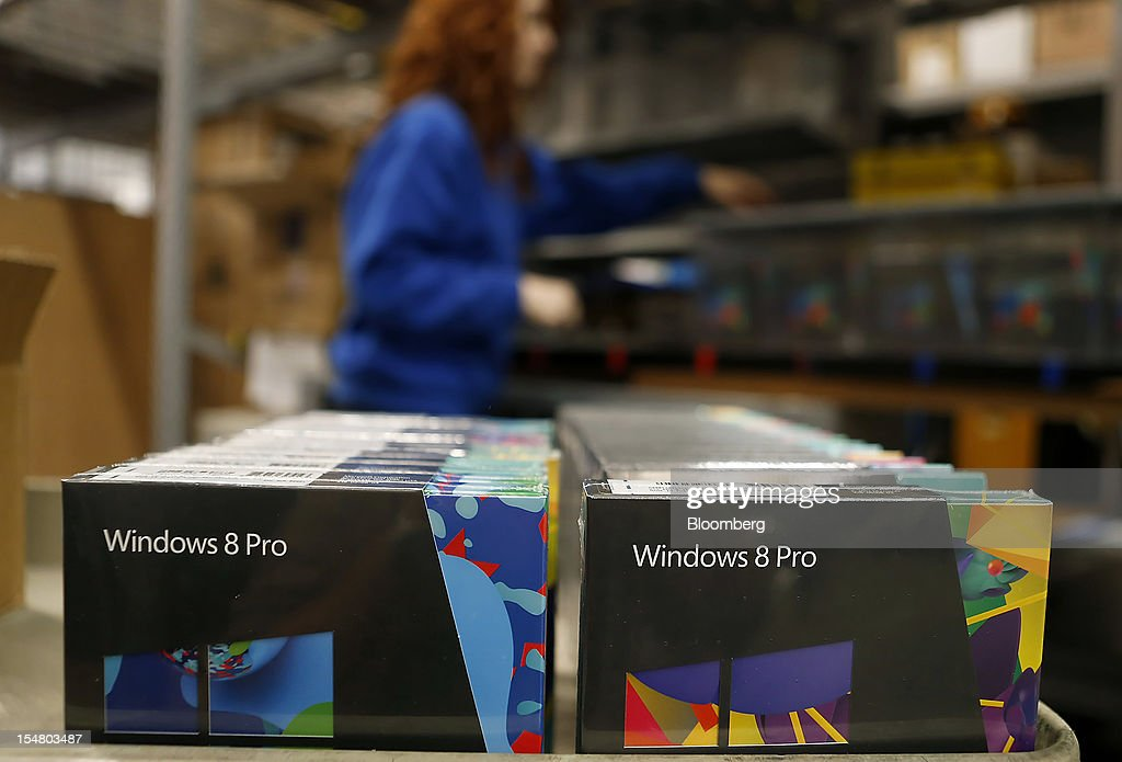 Employee Melissa Jarvis unpacks boxes of Microsoft Corp. Windows 8 operating systems at a Best Buy Co. store in Orem, Utah, U.S., on Friday, Oct. 26, 2012. Microsoft Corp. introduced the biggest overhaul of its flagship Windows software in two decades, reflecting the rising stakes in its competition with Apple Inc. and Google Inc. for the loyalty of customers who are shunning personal computers and flocking to mobile devices. Photographer: George Frey/Bloomberg via Getty Images