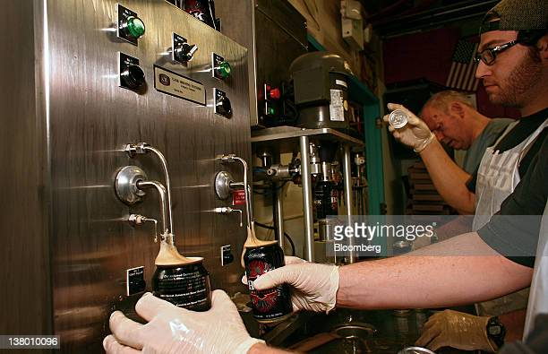 Employee Michael Knez fills empty cans with Wynkoop Brewing Co's B3K Black Lager at the company's facility in Denver Colorado US on Thursday Jan 26...