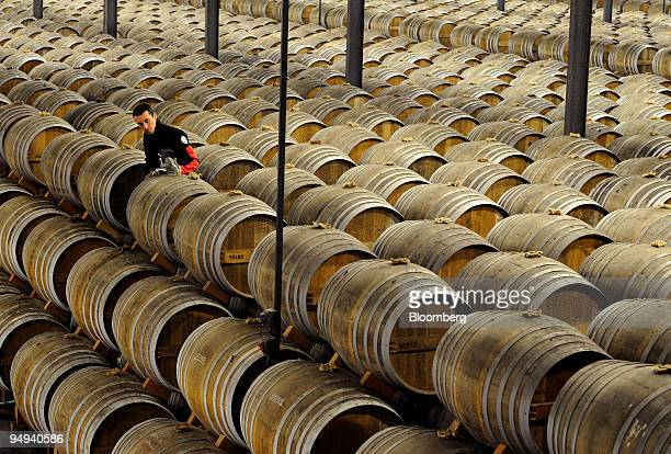 Employee Michael Meunier inspects barrels of cognac at the Remy Martin distillery in Cognac France on Tuesday April 14 2009 Remy Cointreau SA...