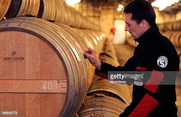 Employee Michael Meunier makes notes on a barrel at the Remy Martin distillery in Cognac France on Tuesday April 14 2009 Remy Cointreau SA France's...