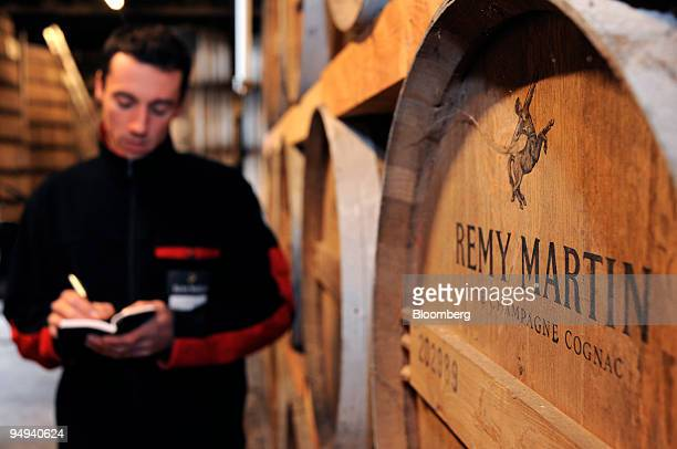 Employee Michael Meunier performs an inspection at the Remy Martin distillery in Cognac France on Tuesday April 14 2009 Remy Cointreau SA France's...