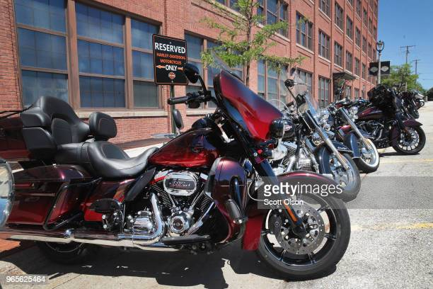 Employee motorcycles are parked outside of the headquarters of iconic American motorcycle builder HarleyDavidson on June 1 2018 in Milwaukee...
