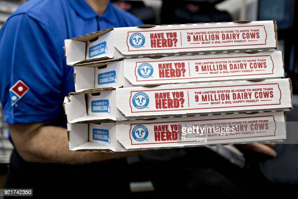A employee moves pizza boxes before a delivery at a Domino's Pizza Inc restaurant in Chantilly Virginia US on Tuesday Feb 20 2018 Domino's released...