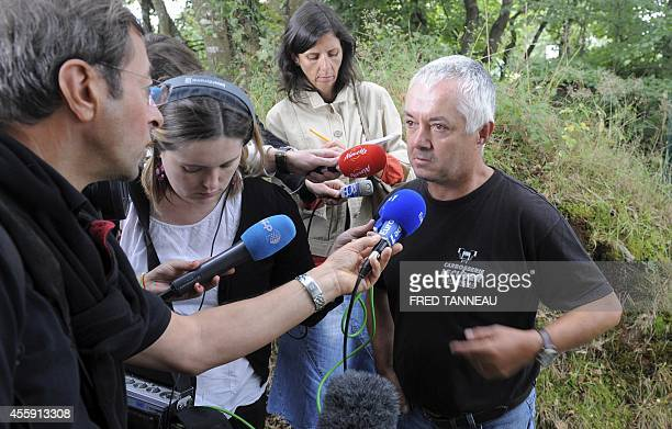 Employee of French poultry export firm TillySabco Didier Coant addresses reporters on September 22 2014 in Guerlesquin western France within a...