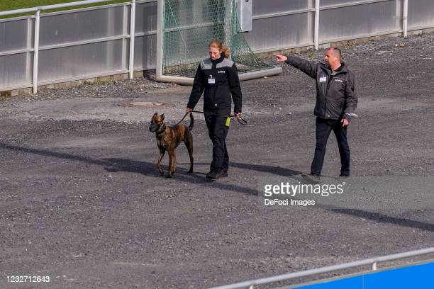 Employee of Security with Dog on the area of FC Schalke 04 during the FC Schalke 04 Training Session on May 03, 2021 in Gelsenkirchen, Germany.