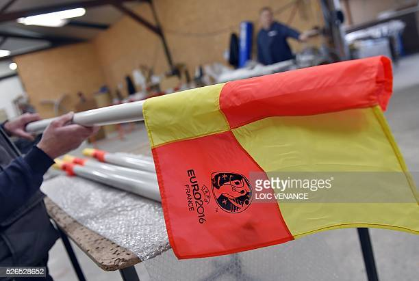 A employee of the Marty Sports company prepares football pitch corner flags to be send to different cities for the UEFA Euro 2016 football...