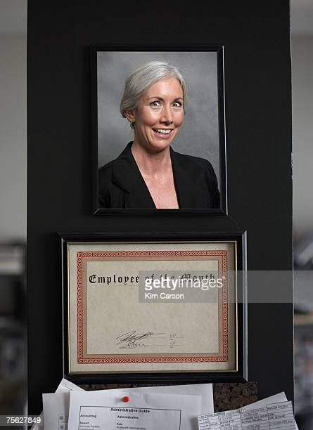 Employee of the month certificate with photo of woman