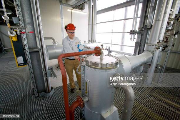 Employee of the oil mill controls the technical system on May 15 2014 in Neuss Germany
