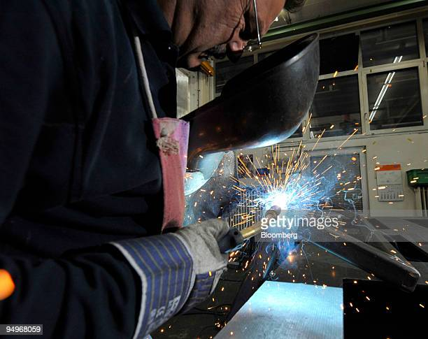 Employee Ozmec Rudolf, welds a rack at the Krones factory in Rosenheim, Germany, on Monday, Sept. 7, 2009. German factory orders rose for a fifth...