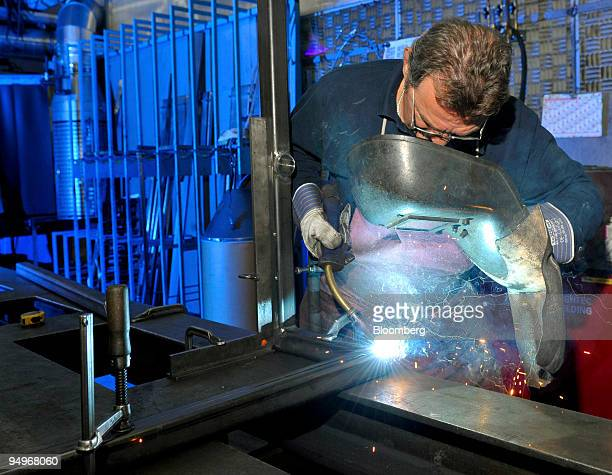 Employee Ozmec Rudolf welds a rack at the Krones factory in Rosenheim Germany on Monday Sept 7 2009 German factory orders rose for a fifth month in...
