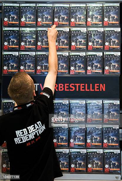 Employee Patrick Hamann organizes copies of Microsoft Corp's Xbox 'Halo Reach' video game at a Game Stop store in Munich Germany on Tuesday Sept 14...