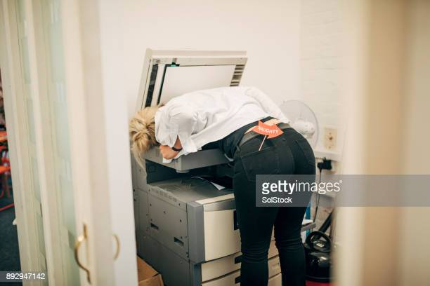 employee photocopying her chest - christmas party stock photos and pictures