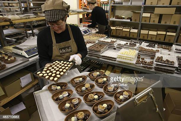 Employee Ramona Boehm packs chocolate Easter eggs at the production facility at Confiserie Felicitas chocolates maker on April 9 2014 in Hornow...