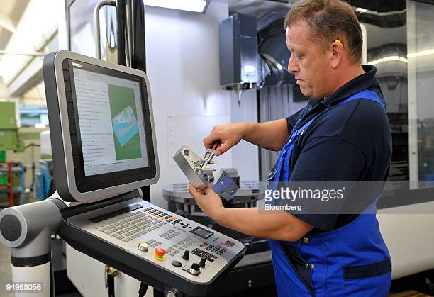Employee Ramond Kuna inspects a component at the Krones factory in Rosenheim Germany on Monday Sept 7 2009 German factory orders rose for a fifth...