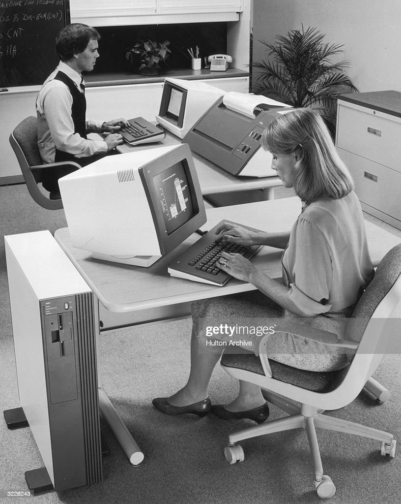 NCR employee Randy Washington and a female colleague using personal computers attached to a central unit called the NCR Tower 1632 at the NCR research and development facility in West Columbia, South Carolina, circa 1982.