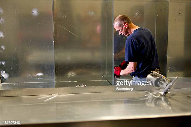 Employee Roger Cosgrove drills holes in a custom storage unit being made for a packaging company at the Giese Manufacturing Co in Dubuque Iowa US on...