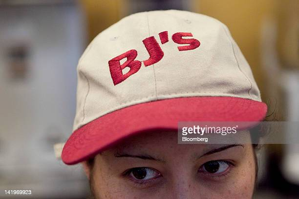 Employee Rubidia Gonzalez stands for a photograph with a BJ's Wholesale Club Inc hat inside the store in Falls Church Virginia US on Tuesday March 27...