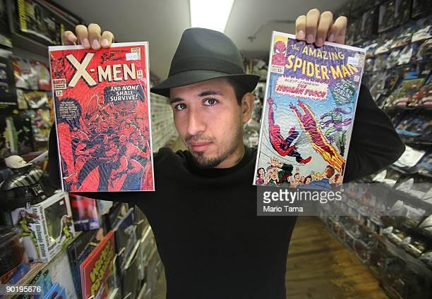 Employee Ryan Mundaca holds vintage Spider Man and XMen Marvel comic books at St Mark's Comics August 31 2009 in New York City The Walt Disney Co...