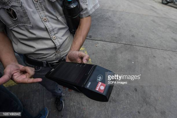 A employee seen showing the new device to control the gasoline use in their oil company during a simulation day The Government of the Bolivarian...