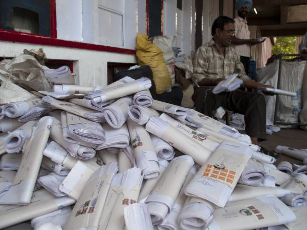 Employee sorting letters in front of the main post office in the capital of Himachal Pradesh