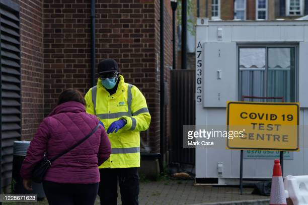 Employee speaks to a member of the public outside a COVID-19 testing centre in Dalston on September 23, 2020 in London, England. Cases have risen to...