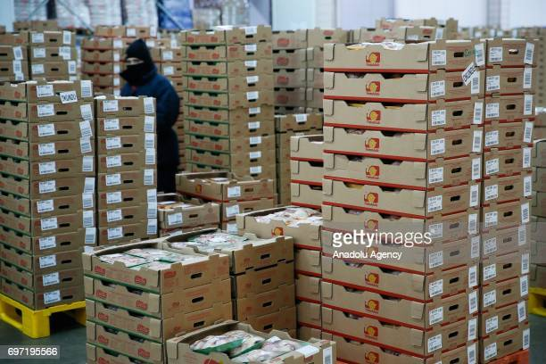 Employee stands next to boxes of freshly packaged chicken in a factory that process chicken meat in Izmir province of Turkey on June 18 2017 The...