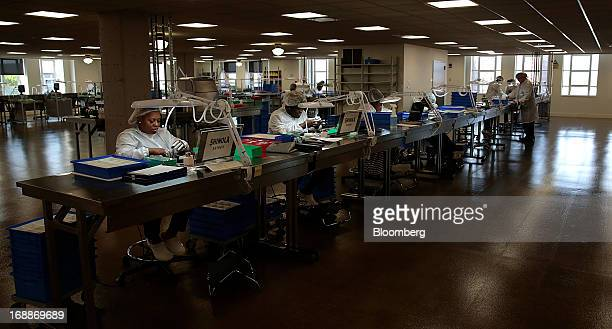 Employee Tenesha Martin left assembles a watch at the Shinola production facility in Detroit Michigan US on Wednesday May 15 2013 Shinola owned by...
