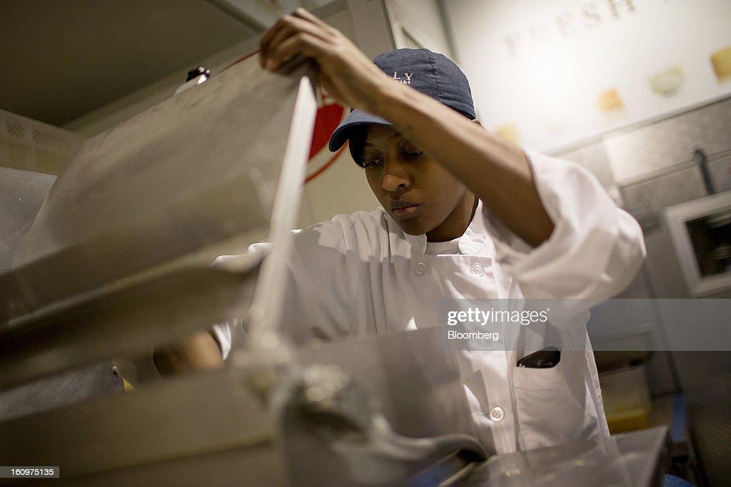 Employee Tiffany Harriott prepares fresh pasta at an Eataly location in the Flatiron district of New York, U.S., on Wednesday, Feb. 6, 2013. Eataly is a high-end Italian food market/mall chain, owned by a partnership including Mario Batali, Lidia Bastianich and Joe Bastianich, which first opened in Turin, Italy, in 2007. Photographer: Scott Eells/Bloomberg via Getty Images