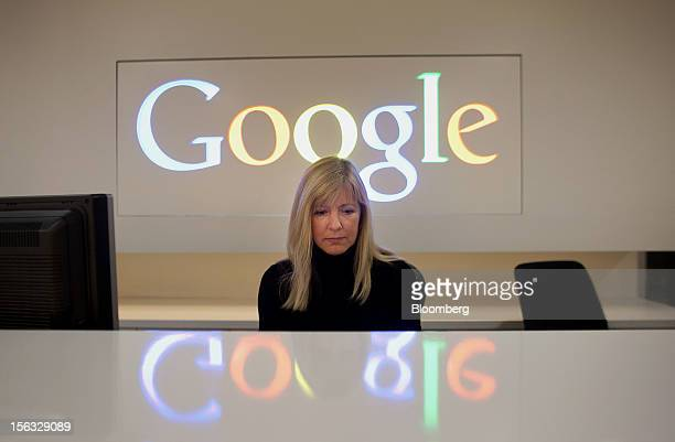 Employee Tracy McNeilly works at the front desk during a media tour for the grand opening of Google Inc's new office in Toronto Ontario Canada on...