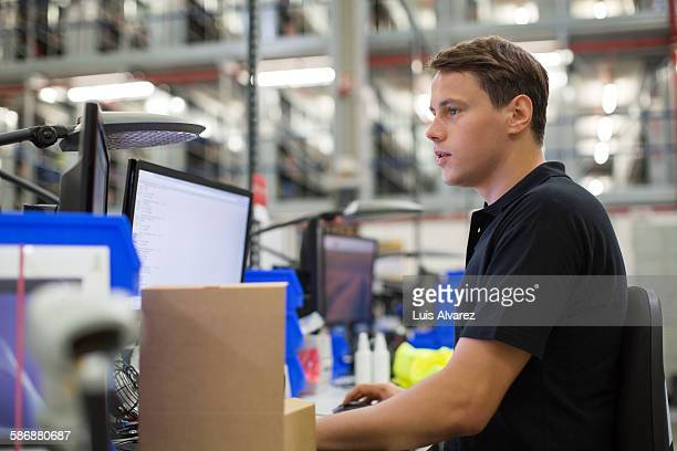 employee using computer in logistics center - distribution warehouse stock pictures, royalty-free photos & images