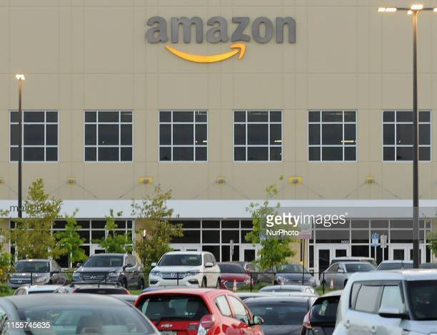 Employee vehicles are seen in the parking lot at an Amazon fulfillment center on July 14 2019 in Orlando Florida On July 15 and 16 Amazon holds its...