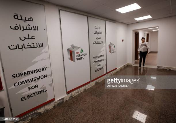 A employee walks at the electoral monitoring committee headquarters in Beirut on April 11 2018 In a first Lebanon's new electoral law has set a...