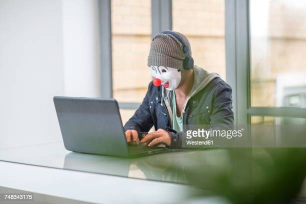 Employee wearing mask and working on laptop