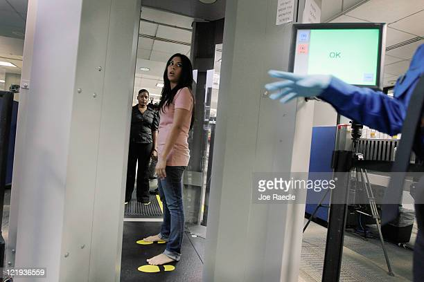 TSA employee who couldn't provide her name demostrates the new advanced imaging technology software known as Automated Target Recognition that has...