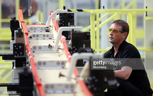 A employee works on a wing component for an Airbus SAS A350 aircraft a unit of European Aeronautic Defence Space Co at GKN Plc's Aerospace factory in...