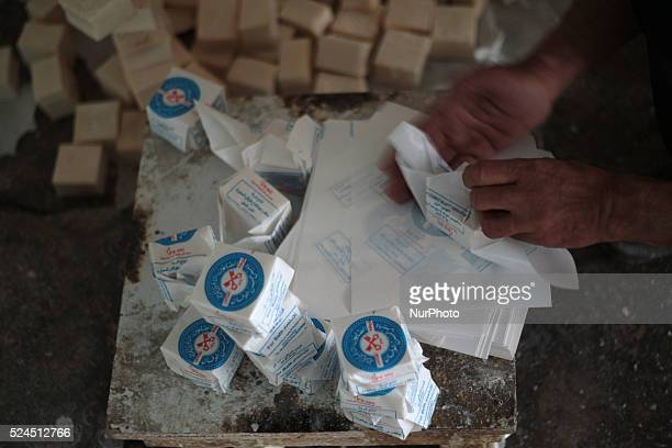 Employee works on packaging soap pieces in Nablus West Bank on May 31 2015 Nablus city northern of the Palestinian territories of the West Bank 49 km...