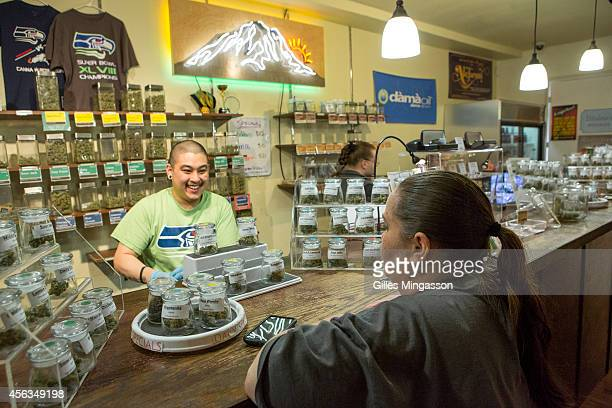 Employees advise clients on the more than twenty strands available at A Greener Today a popular cannabis store in Seattle on March 14 2014 in Seattle...