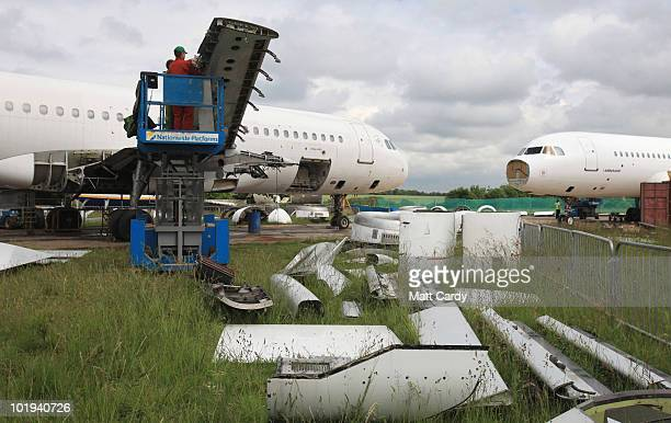 Employees Air Salvage International continues the process of dismantling a Airbus A320 on June 9, 2010 in Kemble, England. The aircraft is one of a...