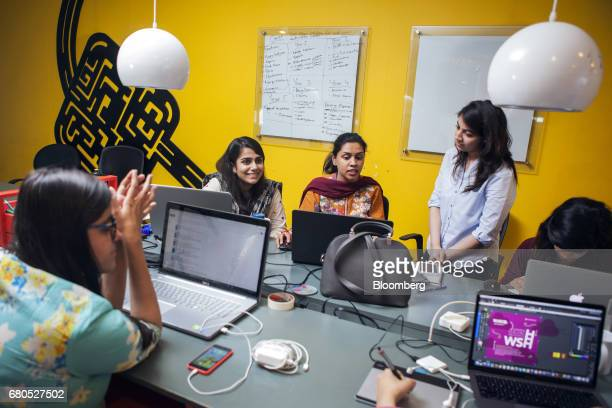Employees and attendees work at The Nest i/o tech incubation center in Karachi Pakistan on Monday April 24 2017 Jehan Ara founder and president of...