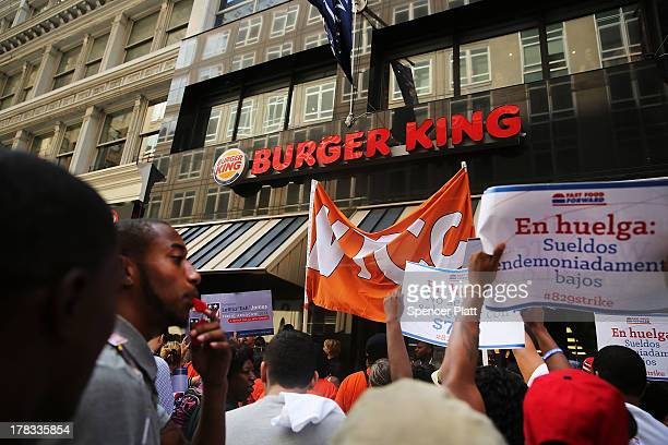 Employees and supporters demonstrate outside of a Wendy's and Burger King fastfood restaurants to demand higher pay and the right to form a union on...