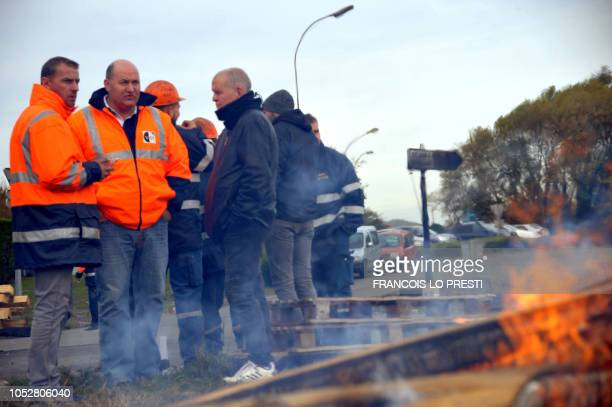 Employees and trade unionist of Acometal protest on October 23 2018 at the entrance to the Ascoval steel factory in SaintSaulve northern France ahead...