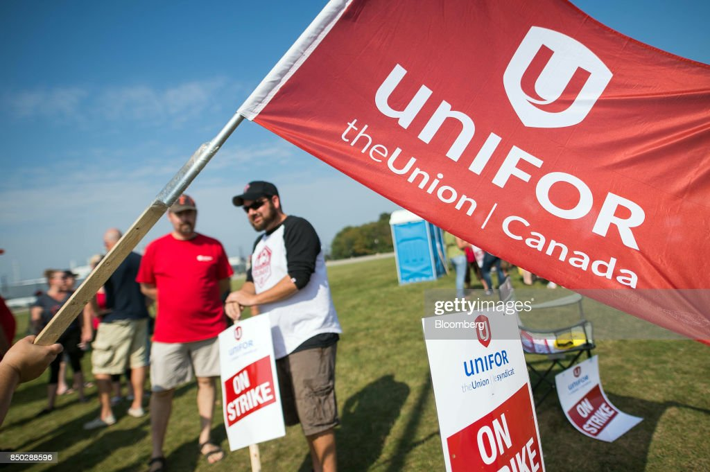 photos et images de gm hit with first canada strike in decades on