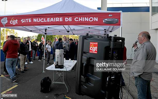 Employees and union members rally in front of the Chinon nuclear power station to protest against the government's proposed labour reforms on May 26...